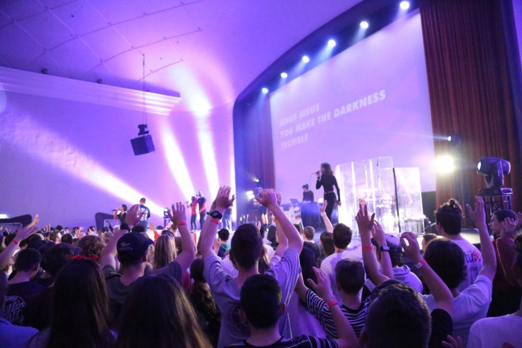 Revred crowd singing with lights